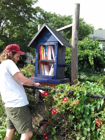 Matt, our neighbor, helping install our Little Free Library.